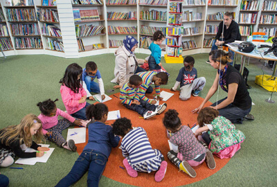 Anna-Christina doing Story Time with the children at the library image