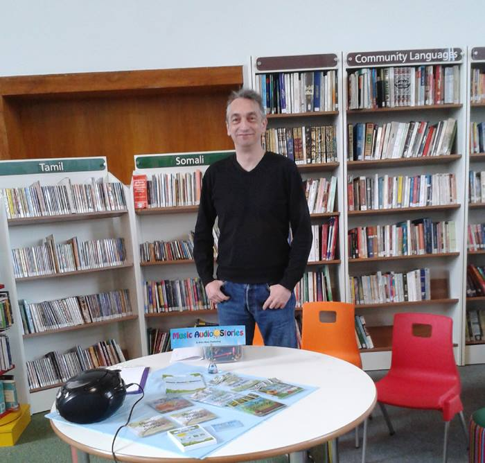 Adie Hardy standing by our merchandise table at the library image