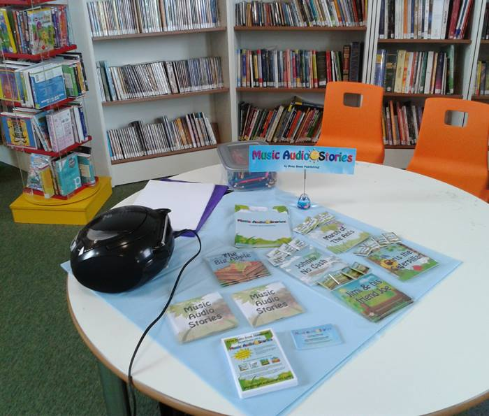 Music Audio Stories table with Cds and flyers on at the library image