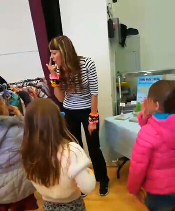 Anna-Christina singing and dancing with the children at the Baby & Children's Market UK