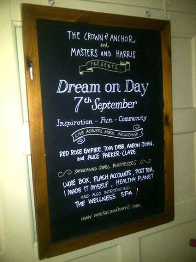 A black board with a list of events on at the Dream On Day event at The Crown in Chiswick image