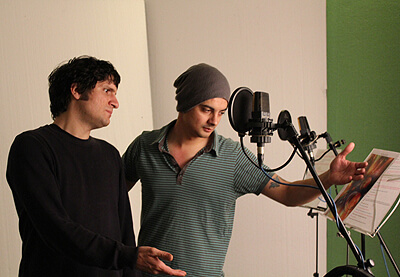 Aris Tsigaras and Aaron John recording in audiobook Robert & Johnson's Space Adventure by Music Audio Stories