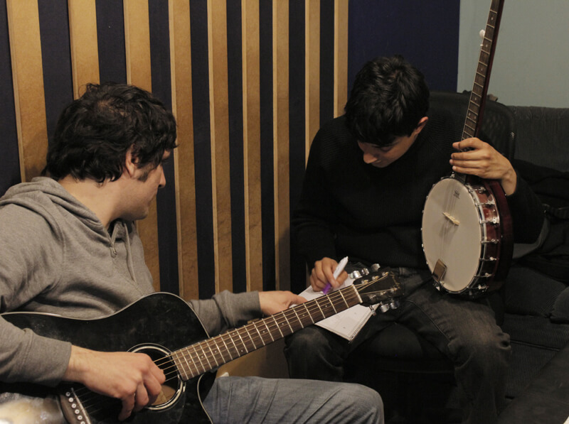 Aris Tsigaras and Aaron John writing their song in the control room for Robert & Johnson's Space Adventure image