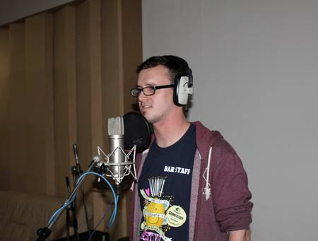 Cormac Mc Coy recording the Bug Club's song in audiobook Litter Bugs by Music Audio Stories