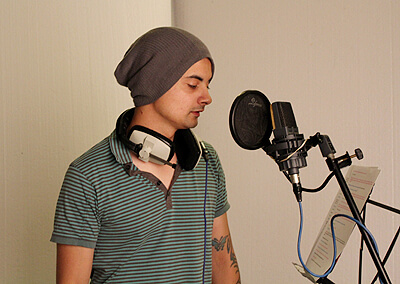 Aaron John recording the voice of Johnson in audiobook Robert & Johnson's Space Adventure by Music Audio Stories