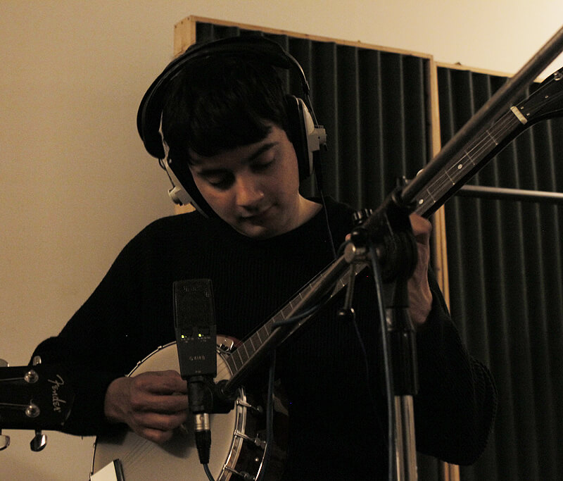 Aaron John recording banjo for Robert & John's song in the studio