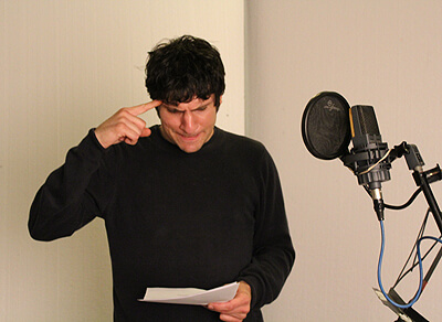 Aris Tsigaras recording the voice of Robert in audiobook Robert & Johnson's Space Adventure by Music Audio Stories